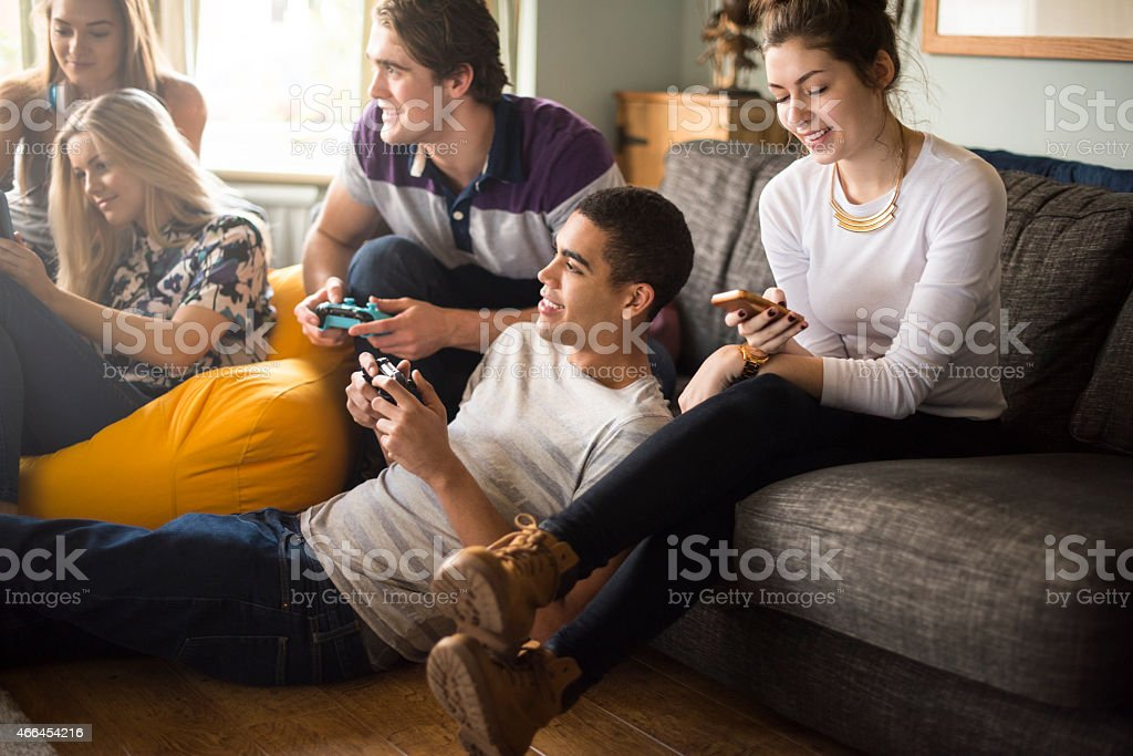 teenagers in the house stock photo