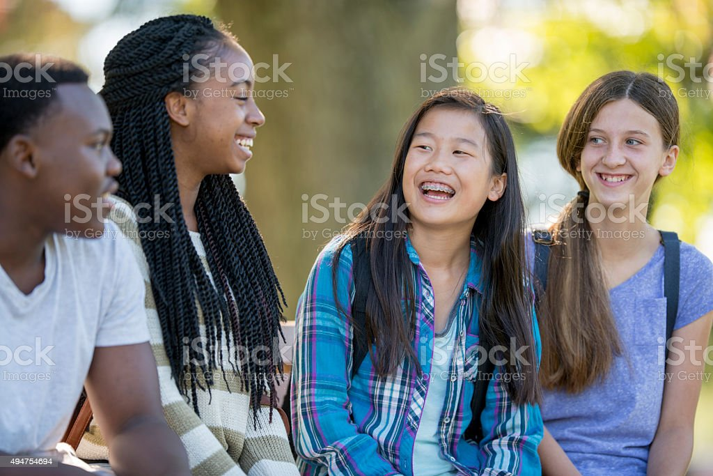 Teenagers Laughing Together stock photo