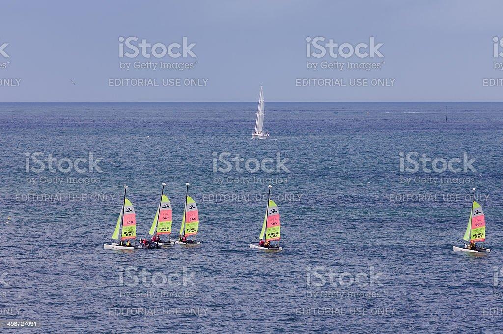 Teenagers learning catamaran sailing in France stock photo