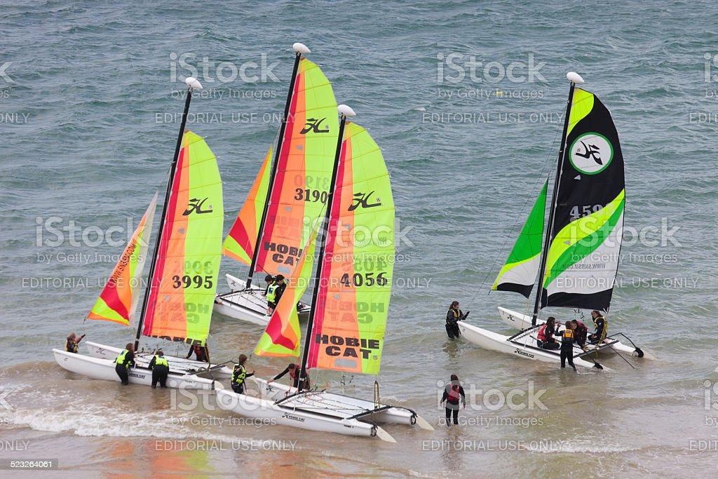Teenagers learning catamaran sailing stock photo