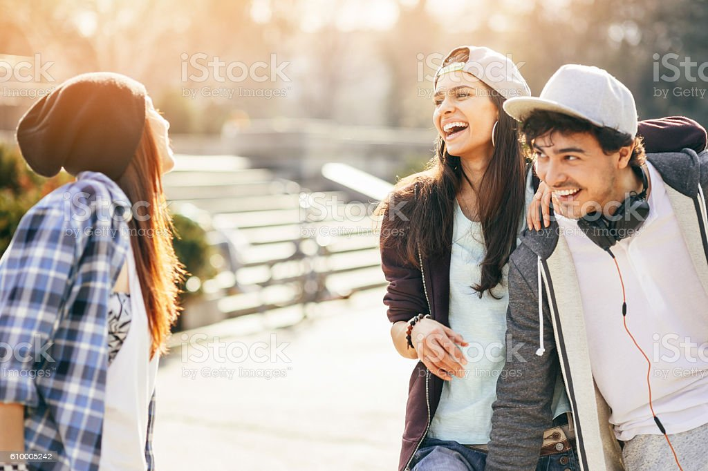Teenagers meeting in the park stock photo