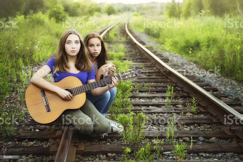 Teenagers mourning on railroad track stock photo