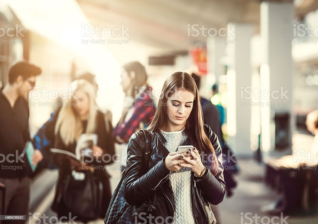 Teenagers on the railway station stock photo