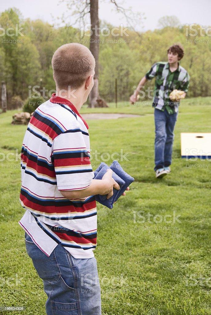 Teenagers Playing Corn Hole stock photo