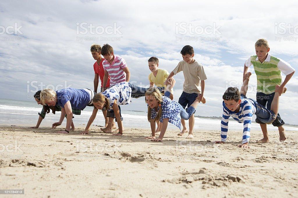 Teenagers playing on beach stock photo