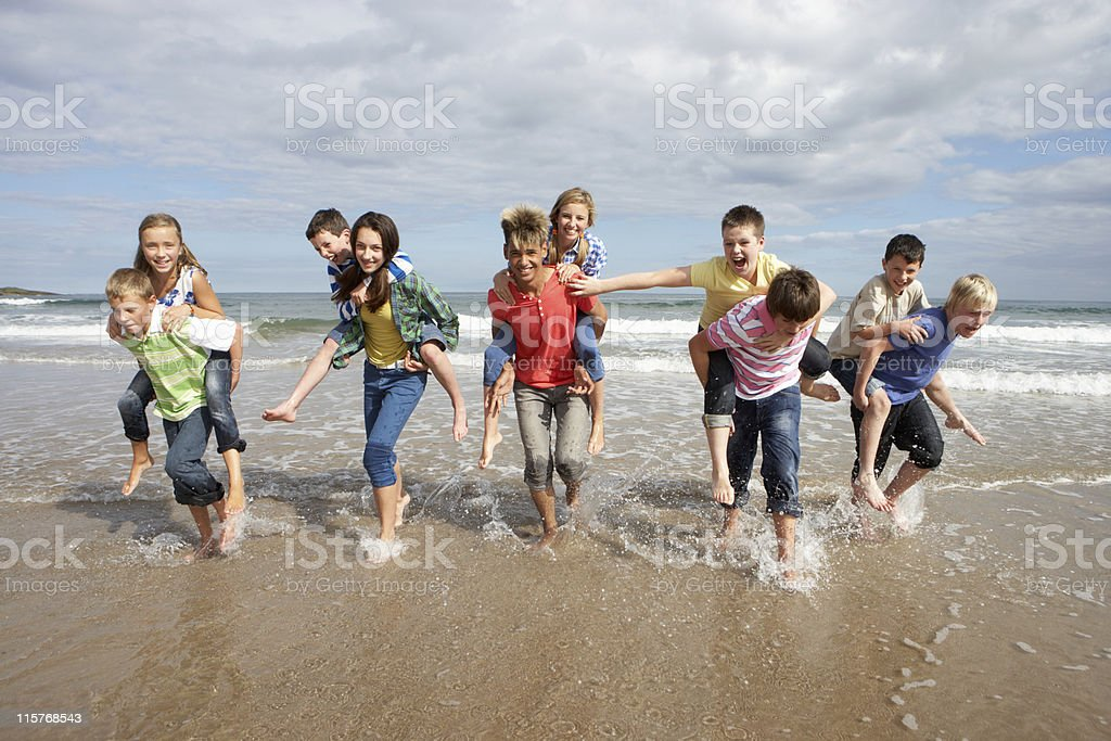 Teenagers playing piggyback royalty-free stock photo