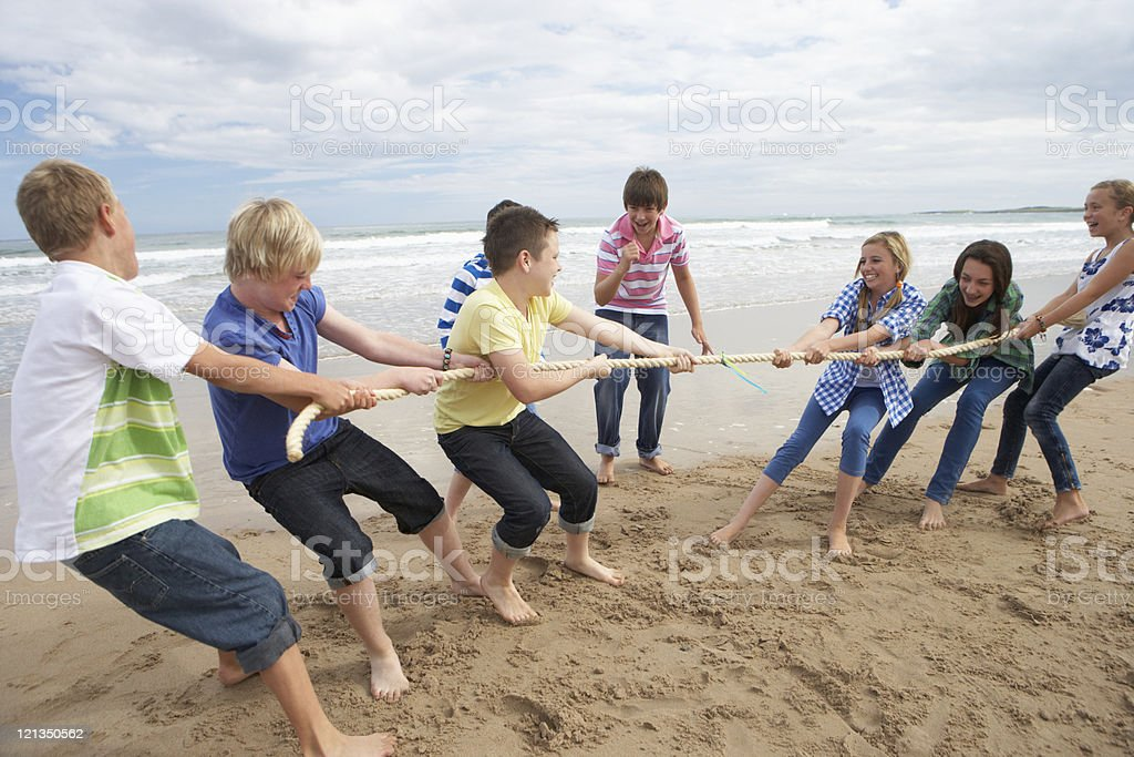 Teenagers playing tug of war royalty-free stock photo