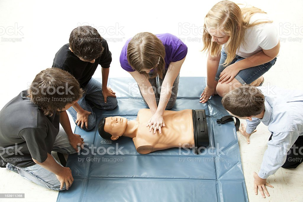 Teenagers Practice CPR royalty-free stock photo