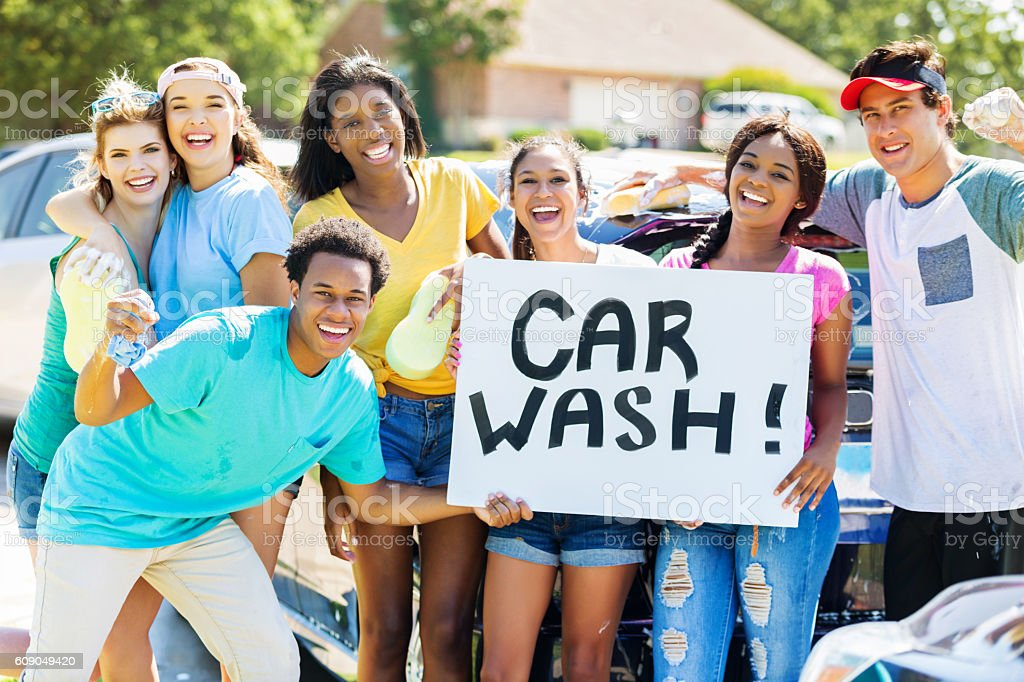 Teenagers promote car wash stock photo
