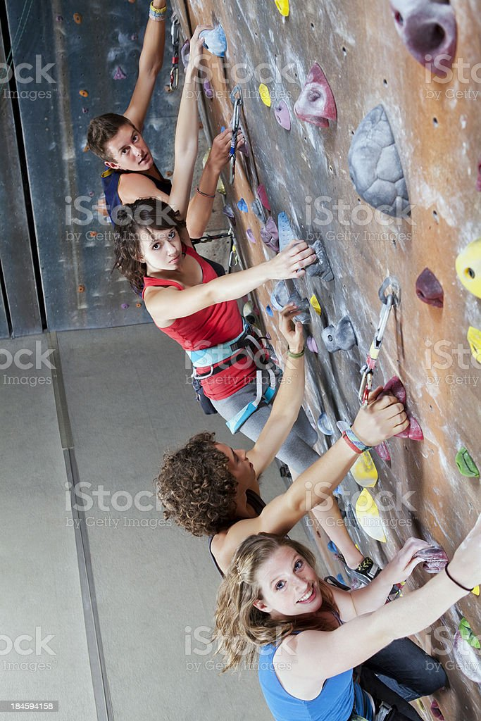 Teenagers Race to the future on a rock climbing wall stock photo