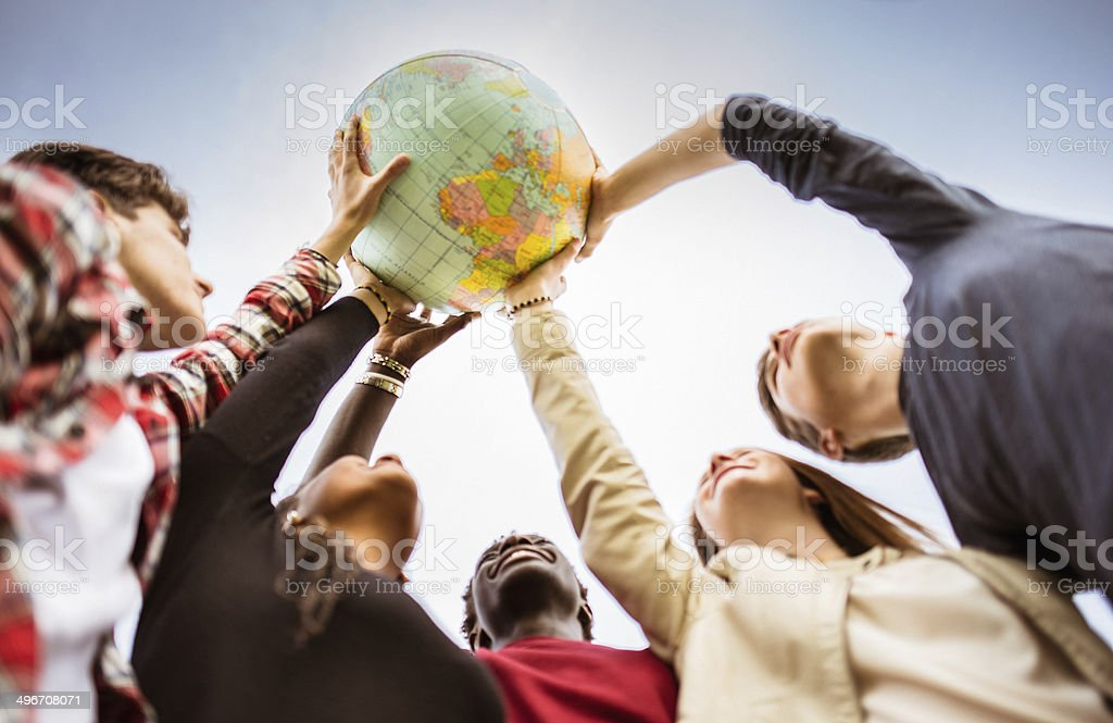 teenagers reaching the world at campus stock photo