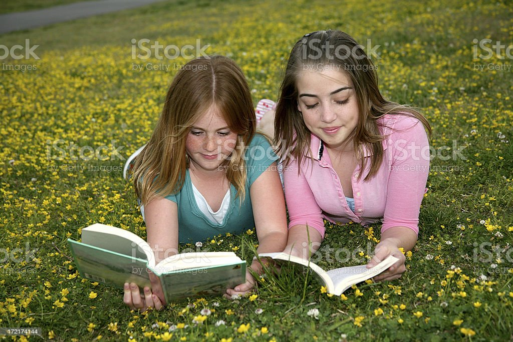 Teenagers reading in the park stock photo