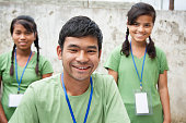 Teenagers register at volunteer, charity event. Multi-ethnic group.