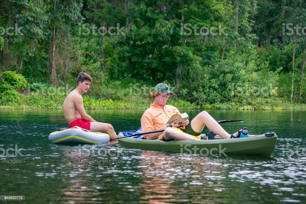 Teenagers Relaxing on the Silver River stock photo