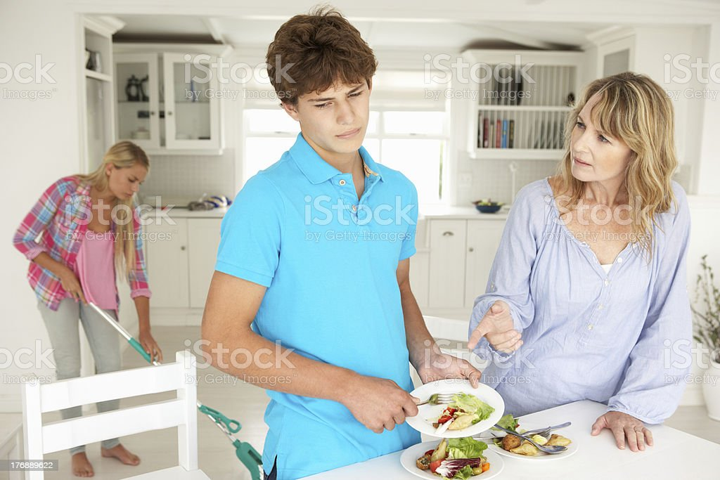 Teenagers reluctant to do housework royalty-free stock photo