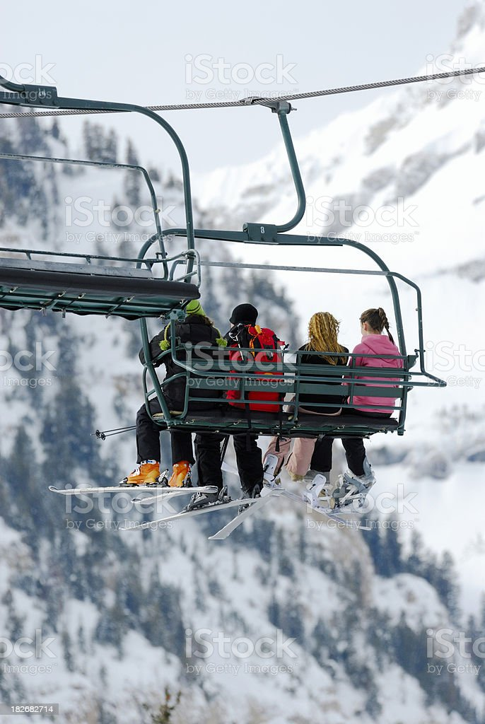 Teenagers Riding Chairlift With Skis and Snowboards. royalty-free stock photo