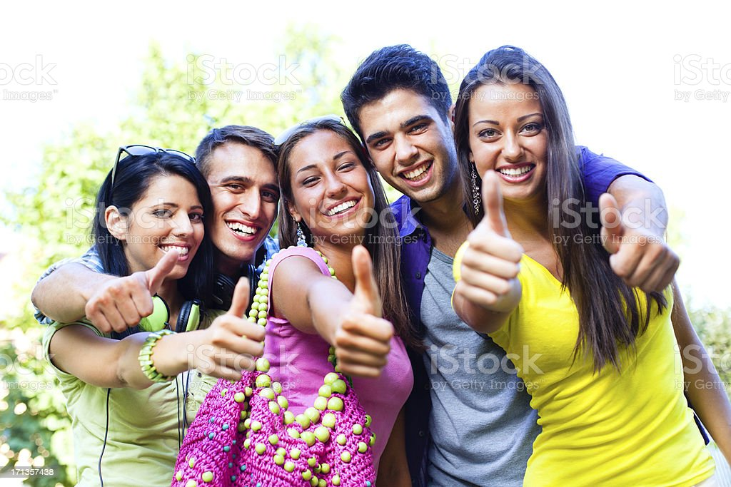 Teenagers showing thumbs up stock photo
