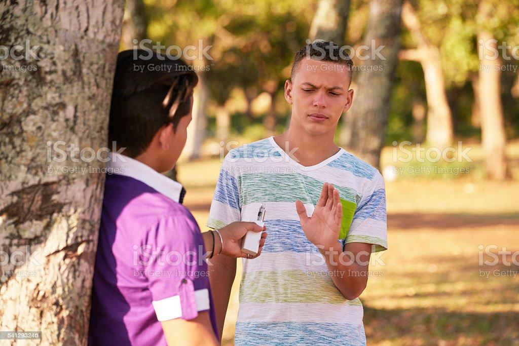 Teenagers Smoking Boy Refusing To Smoke E-cig stock photo