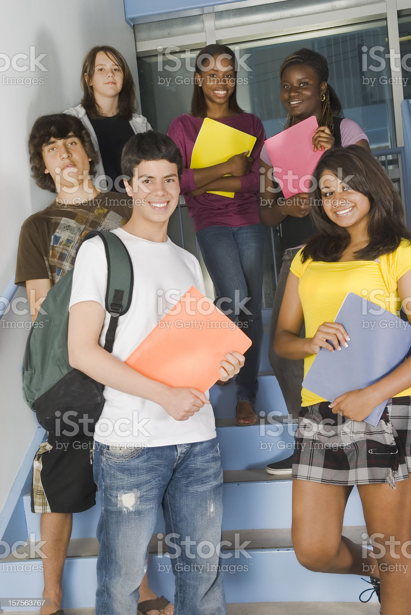 Teenagers standing on the school staircase - II royalty-free stock photo