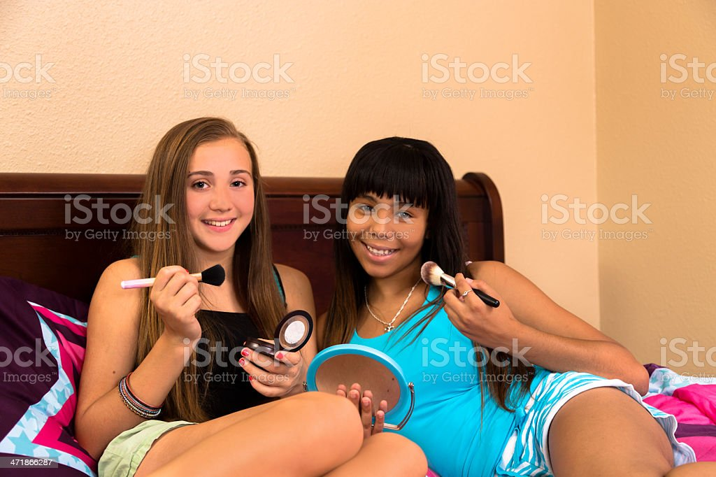 Teenagers:  Teens in bedroom doing their make-up. royalty-free stock photo