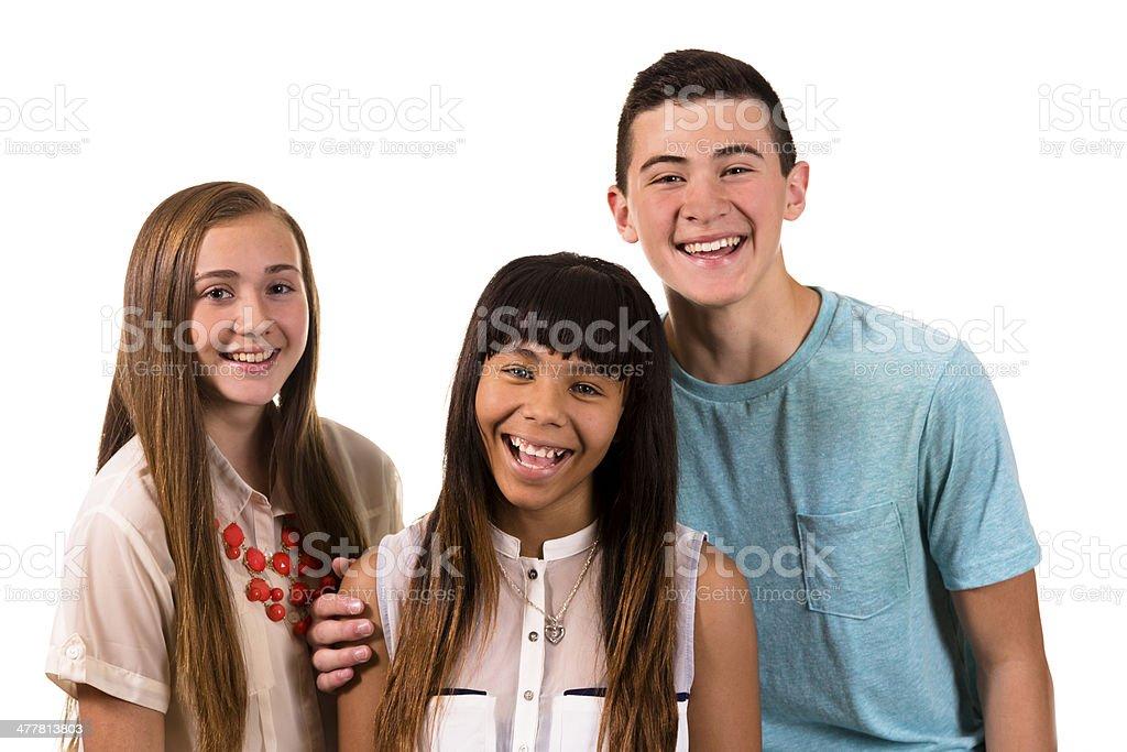 Teenagers:  Three happy multi ethnic teens laughing. royalty-free stock photo
