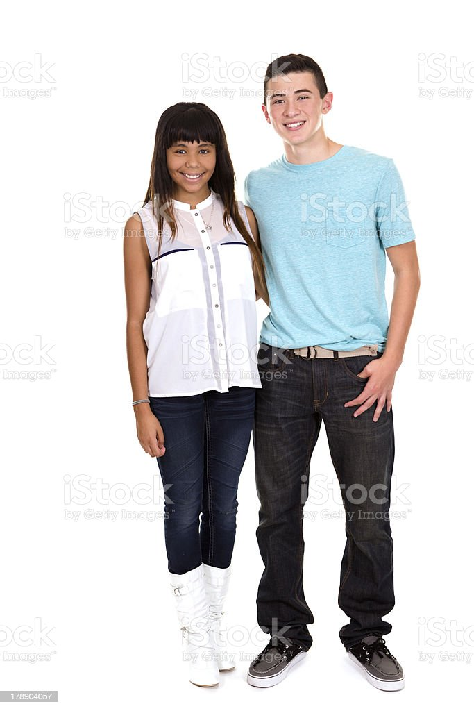 Teenagers: Two happy multi ethnic teens smiling. royalty-free stock photo