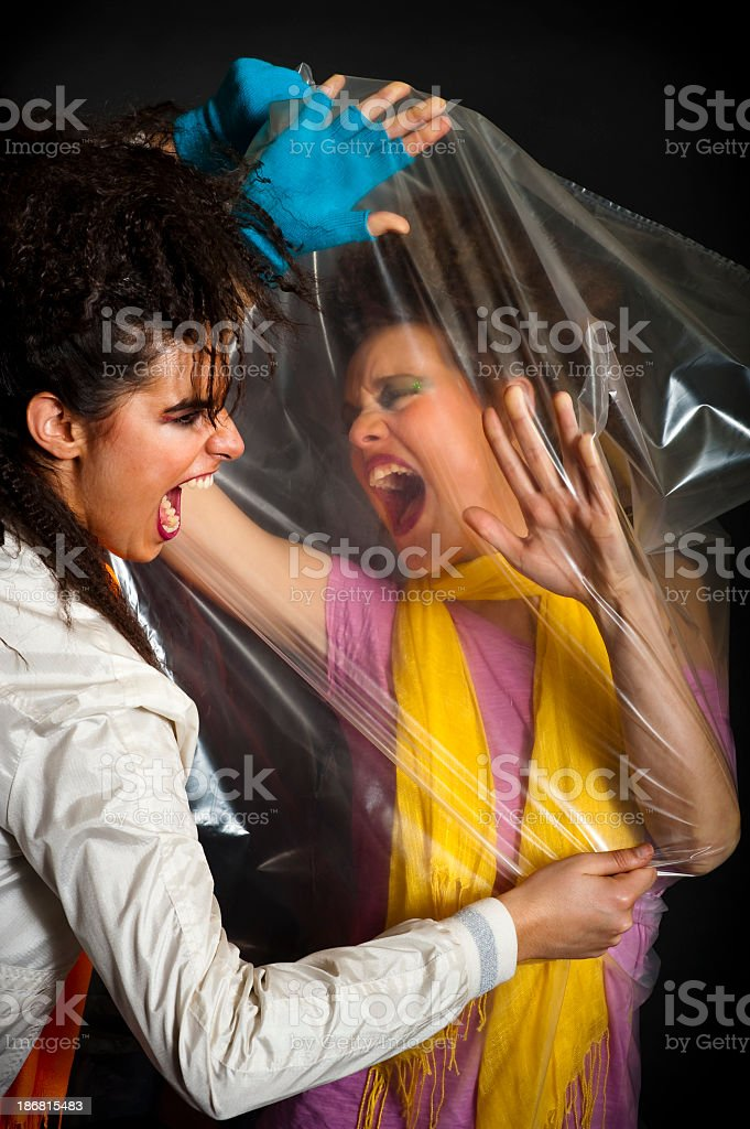 Teenagers violence with a plastic bag royalty-free stock photo