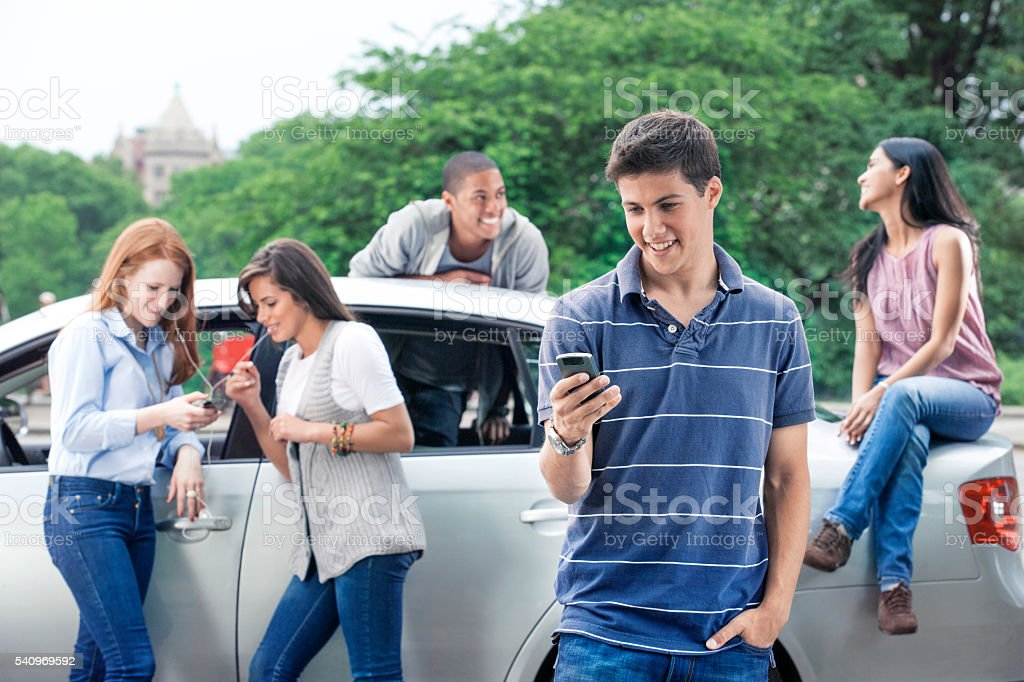 Teenagers with car stock photo