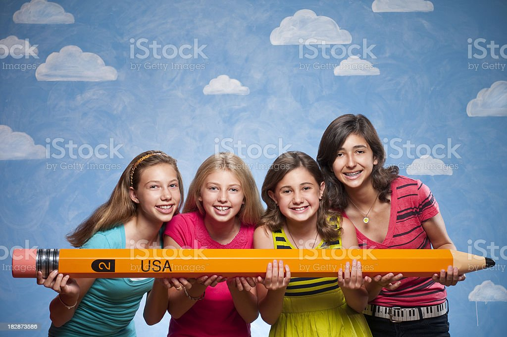 Teenagers With Oversized Pencil stock photo