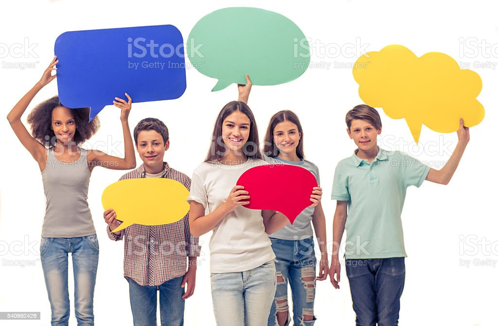 Teenagers with speech bubbles stock photo