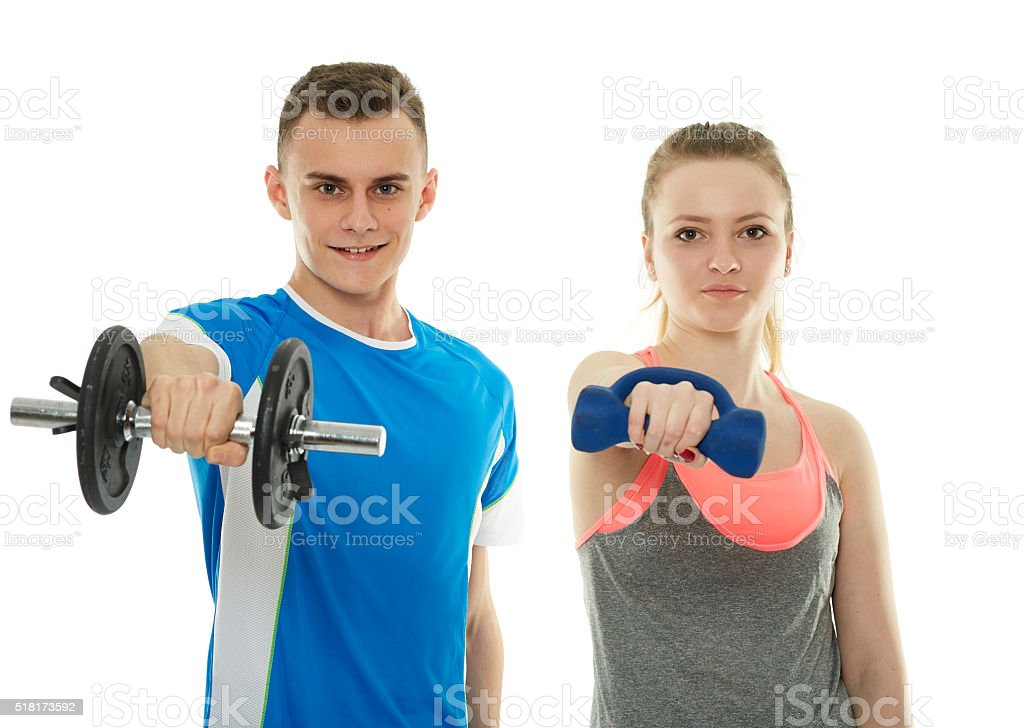 Teenagers working out with dumbbells stock photo