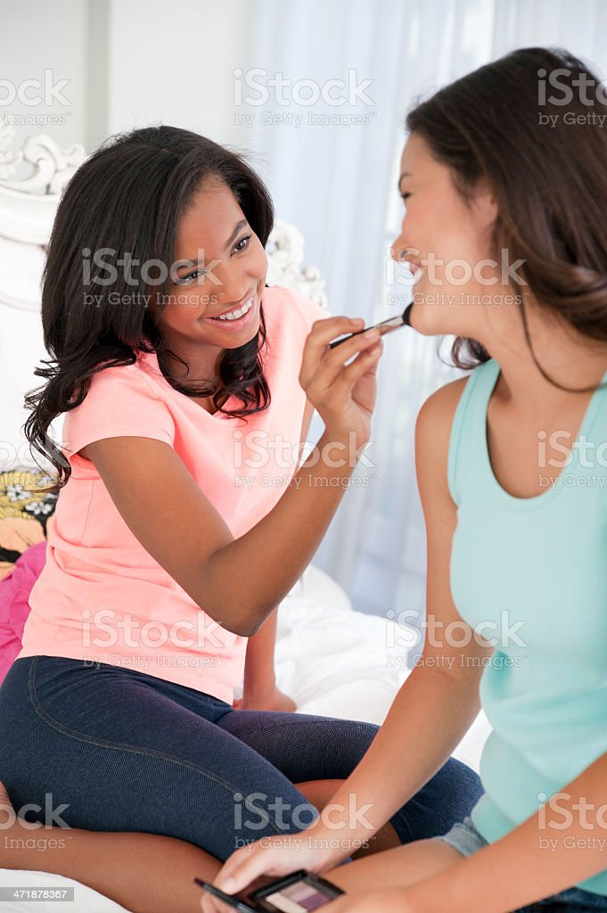 Teens applying makeup royalty-free stock photo