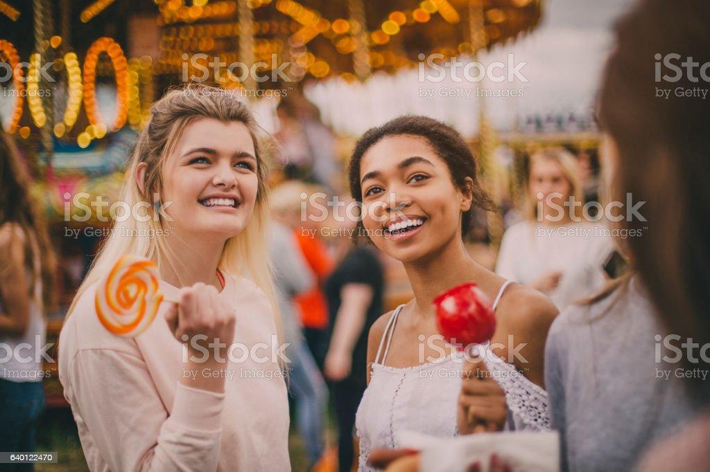 Teens at amusement park stock photo