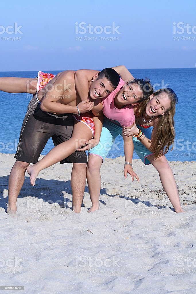 teens at beach having piggyback fun on spring break royalty-free stock photo