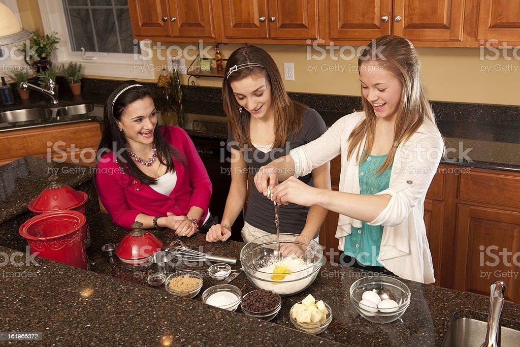 Teens baking chocolate chip cookies (series) stock photo