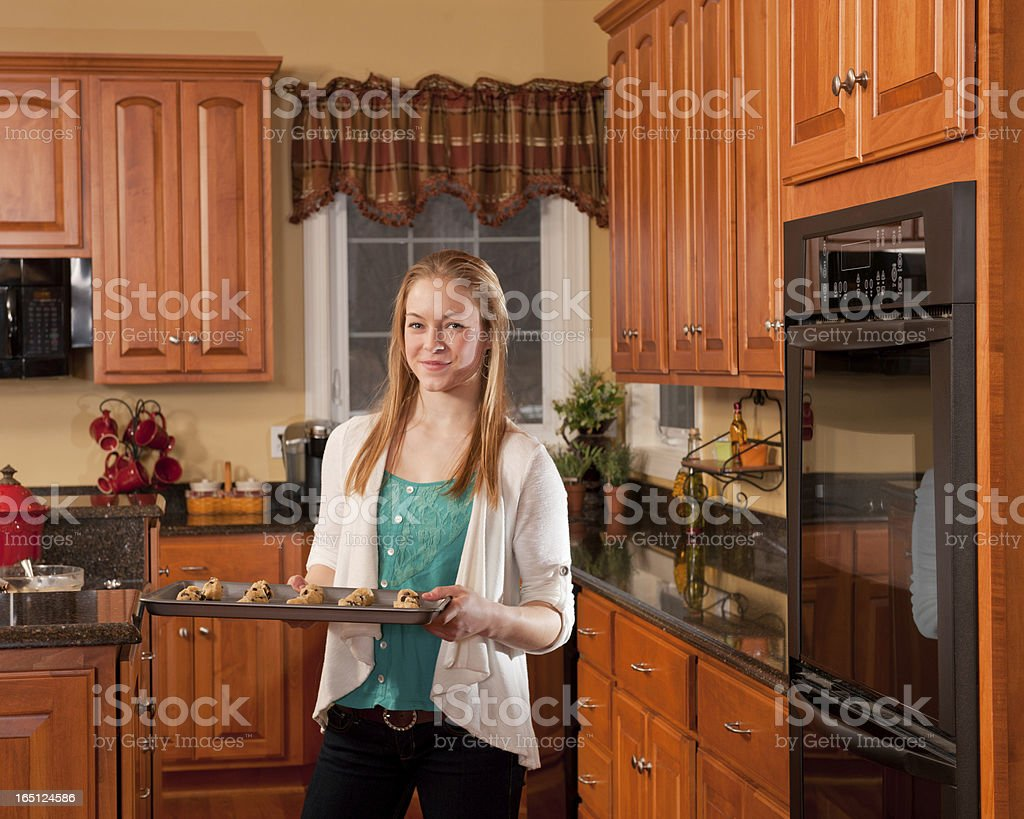 Teens baking chocolate chip cookies (series) royalty-free stock photo