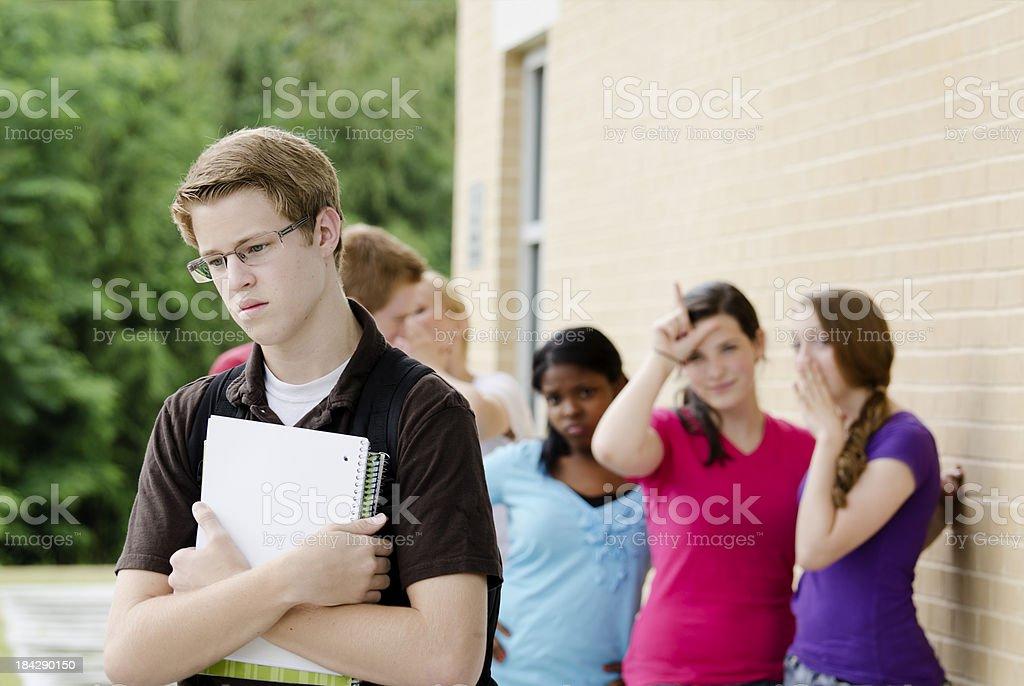 Teens Bullying the Nerd stock photo