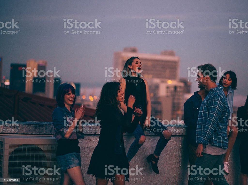 Teens celebrating a funny rooftop party stock photo