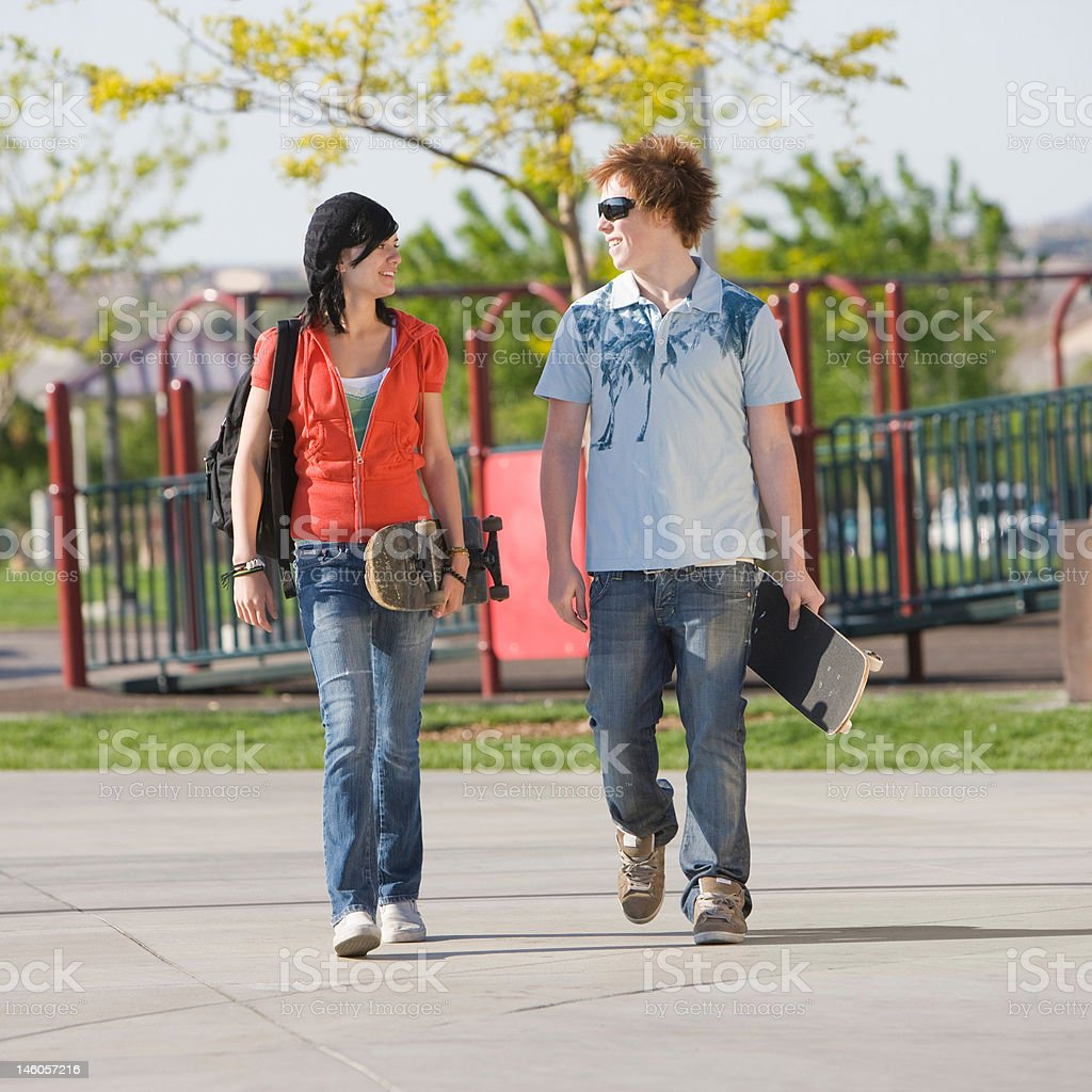 Teens couple walks royalty-free stock photo