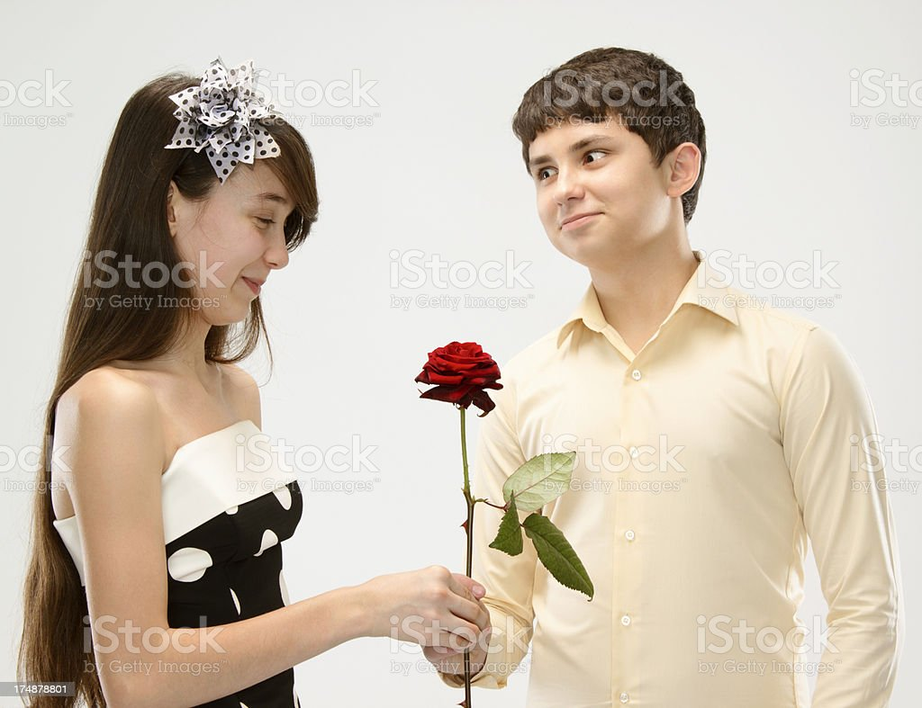 Teens couple with rose royalty-free stock photo