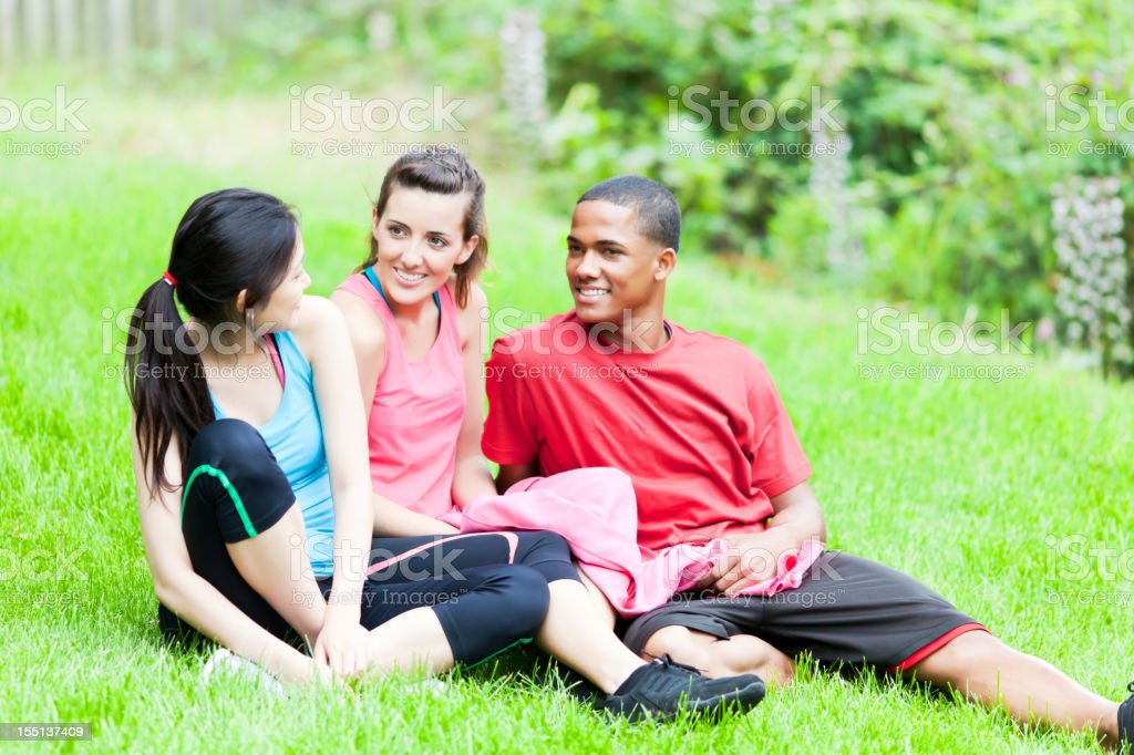 Teens exercising in the park having a rest royalty-free stock photo