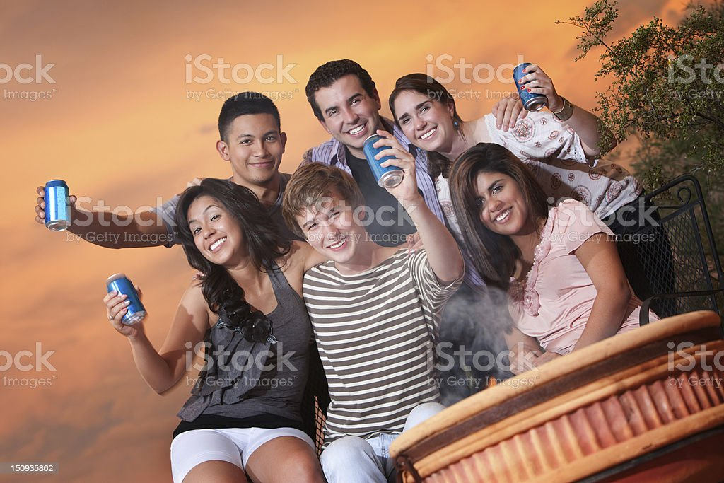 Teens Hold Cans stock photo