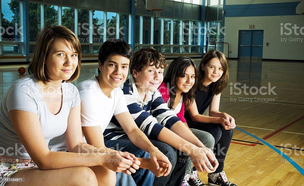Teens in a Row, Highschool Gymnasium royalty-free stock photo