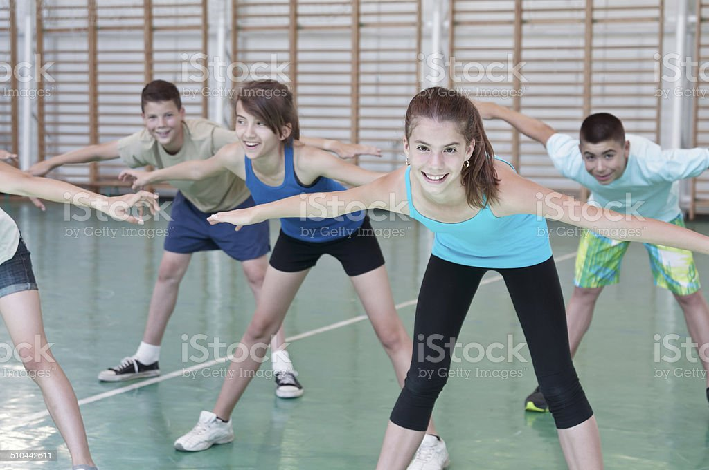 Teens in gymnasium stock photo
