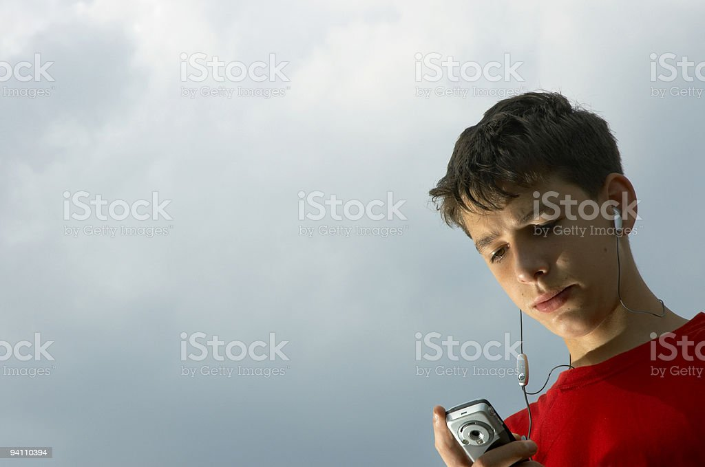 teens listen to mp3 player stock photo
