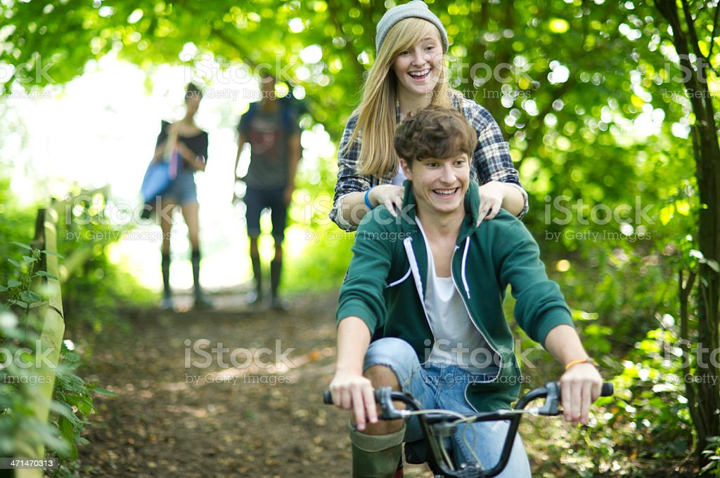 teens off road cycling royalty-free stock photo