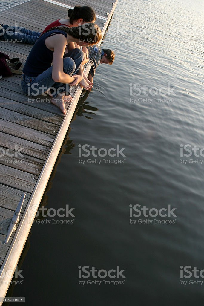 Teens on a Pier royalty-free stock photo