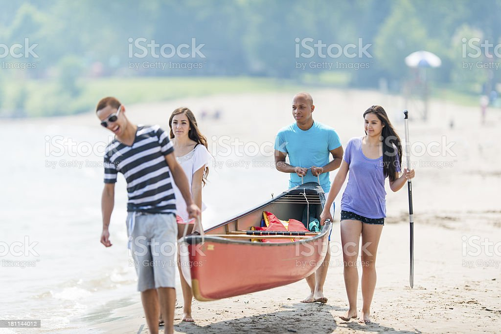 Teens on Canoe Trip royalty-free stock photo