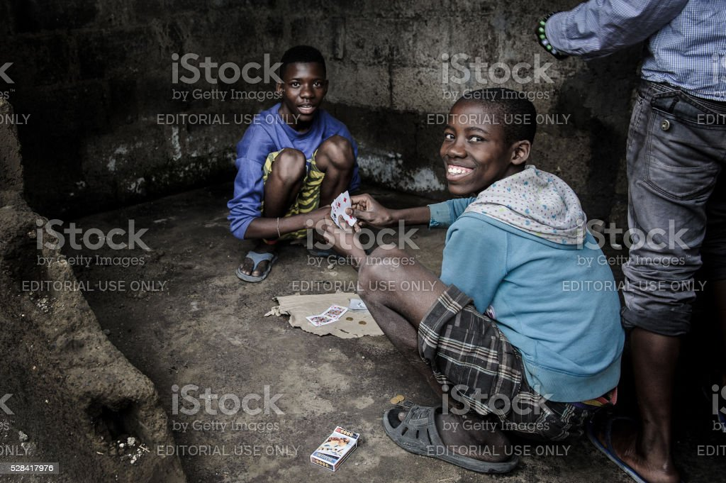 Teens Playing Cards in Misisi stock photo