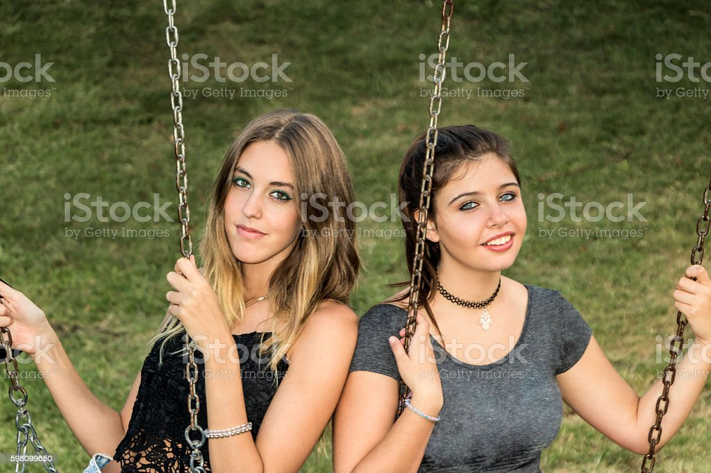 Teens playing in the park stock photo